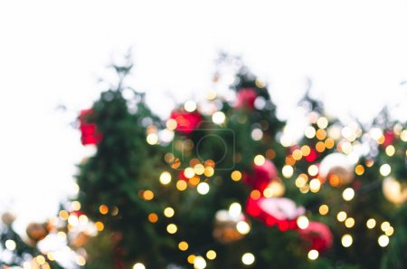 Photo for Defocused decorated Christmas tree with colorful lights on a white background - Royalty Free Image