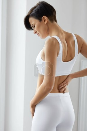Pain. Beautiful Female Having Painful Feeling In Back, Backache