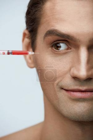 Portrait Of Handsome Man Face Getting Facial Beauty Injections