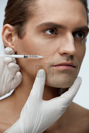 Male Beauty Injection. Handsome Man Receiving Facial Injections