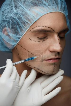 Male Face Beauty Injections. Handsome Man Getting Skin Injection