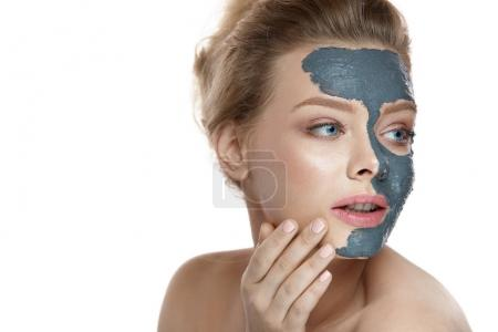 Photo for Beauty Face Care. Portrait Of Sexy Young Girl Touching Her Perfect Soft Facial Skin. Closeup Of Healthy Beautiful Female With Natural Makeup Applying Grey Clay Mask On Face. Spa Concept. High Resolution - Royalty Free Image