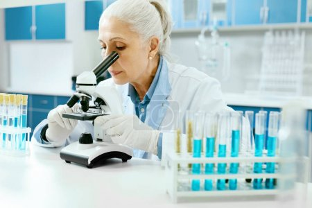 Laboratory Research. Woman Looking Through Microscope.