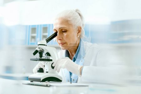 Clinical Test. Female Scientist Working In Laboratory.