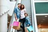 """Постер, картина, фотообои """"Family Shopping. Happy People In Mall"""""""