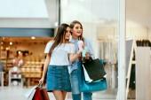"""Постер, картина, фотообои """"Girls Shopping. Female Friends In Mall"""""""