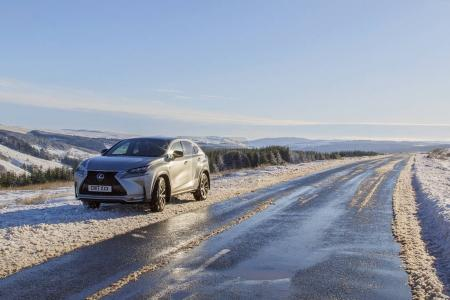 Brecon Beacons, UK: December 11, 2017: A Lexus NX 300h F-Sport crossover hybrid car on the road side in snow and icy conditions.