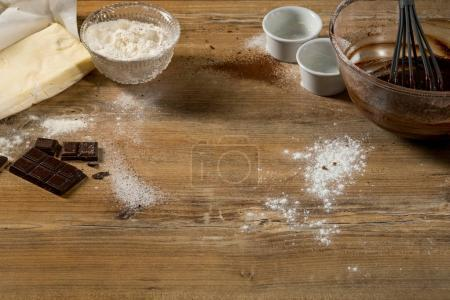 close-up of delicious black chocolate with sugar powder on wooden table