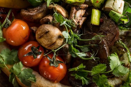 vegetables with homemade bread on plate cooking on coal