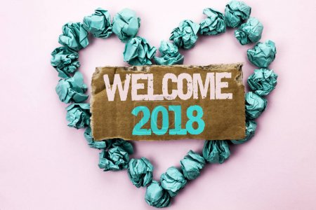 Writing note showing  Welcome 2018. Business photo showcasing Celebration New Celebrate Future Wishes Gratifying Wish written on Tear Cardboard on Plain background on Heart Paper Balls.