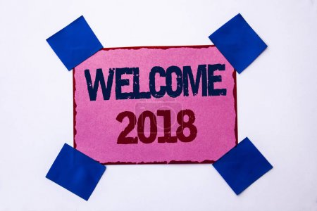 Conceptual hand writing showing Welcome 2018. Business photo text Celebration New Celebrate Future Wishes Gratifying Wish written on Pink Sticky Note Paper on the plain background.