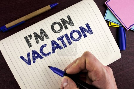 Conceptual hand writing showing I Am im On Vacation. Business photo showcasing Break from stressful work pressure travel worldwide written by Man on Notebook Book on wooden background Pen.