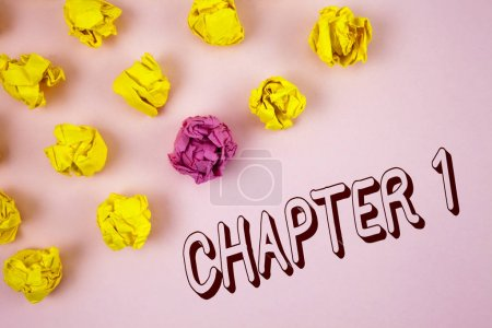 Text sign showing Chapter 1. Conceptual photo Starting something new or making the big changes in one s journey written on plain Pink background Crumpled Paper Balls next to it.