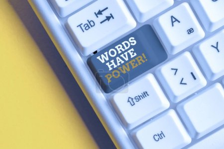 Text sign showing Words Have Power. Conceptual photo as they has ability to help heal hurt or harm someone White pc keyboard with empty note paper above white background key copy space.
