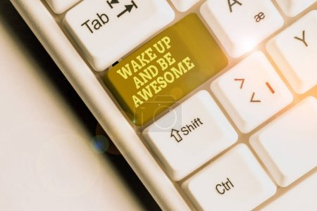 Foto de Word writing text Wake Up And Be Awesome. Presentación de fotos de negocios Rise up and Shine Start the day Right and Bright White pc keyboard with empty note paper above white background key copy space. - Imagen libre de derechos