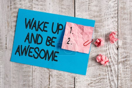 Photo for Word writing text Wake Up And Be Awesome. Business photo showcasing Rise up and Shine Start the day Right and Bright Wrinkle paper and cardboard plus stationary placed above wooden background - Royalty Free Image