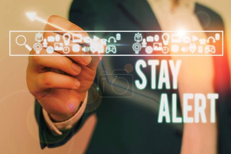 Photo for Text sign showing Stay Alert. Business photo showcasing Paying full attention to things around Quick to see or understand - Royalty Free Image