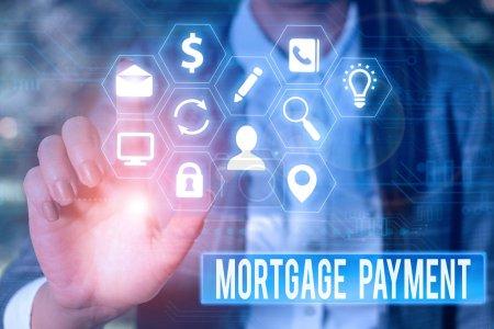 Photo pour Ecriture conceptuelle montrant le paiement hypothécaire. Notion montant périodique versé à un titulaire pour le remboursement d'un prêt - image libre de droit