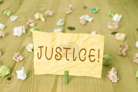 Writing note showing Justice. Business concept for...