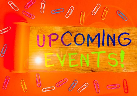 Photo for Text sign showing Upcoming Events. Business photo text thing that will happens or takes place soon planned occasion Paper clip and torn cardboard placed above a wooden classic table backdrop - Royalty Free Image