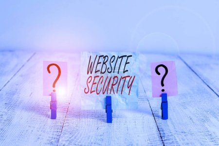 Writing note showing Website Security. Business photo showcasing critical component to protect and secure websites Crumbling sheet with paper clips placed on the wooden table.