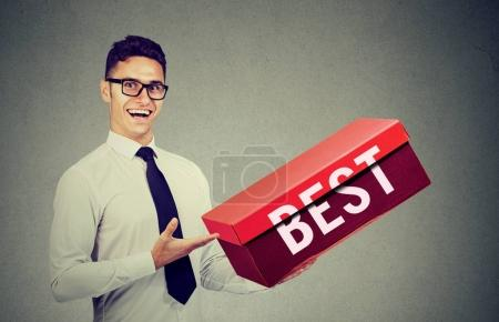 Smiling salesman business man advertising his best...