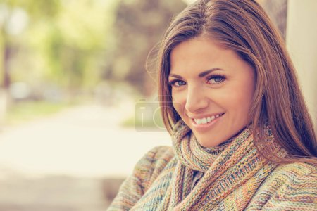 Photo for Smiling woman with perfect smile and white teeth in a park looking at camera - Royalty Free Image