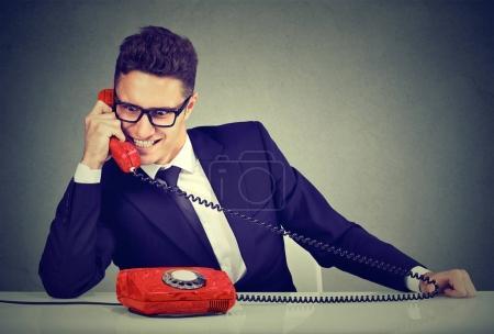 Pushy young salesman business man advertising his ...