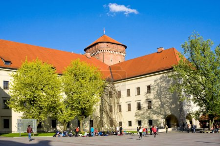 CRACOW, POLAND - APRIL 25, 2016:: People walking at territory of Wawel Castle