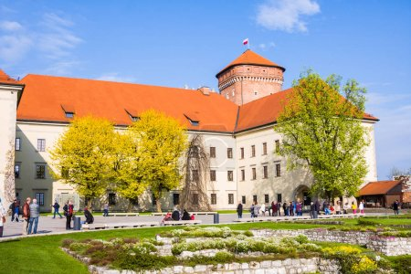 CRACOW, POLAND - APRIL 21, 2017: People walking at territory of Wawel Castle