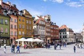 Warsaw, Poland - April 23, 2017: Colorful houses in Castle Square in the Old Town of Warsaw, capital of Poland.