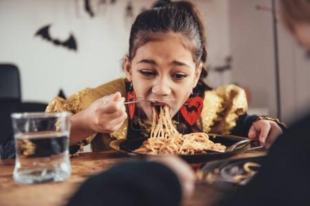 girls eating spaghetti in halloween