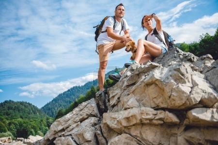 couple with small yellow dog