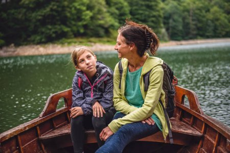 Mother and daughter rowing boat
