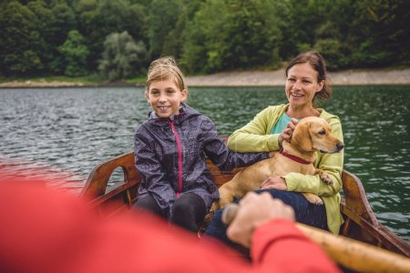 Family with small yellow dog