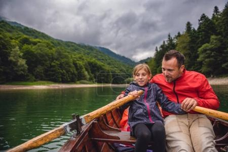 Father and daughter rowing boat