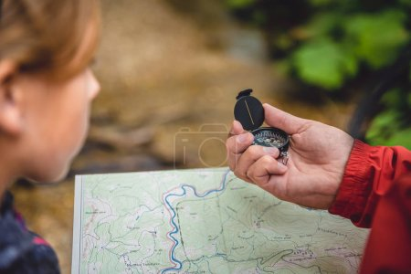 woman and daughter checking map