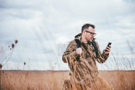 Hiker using smart phone