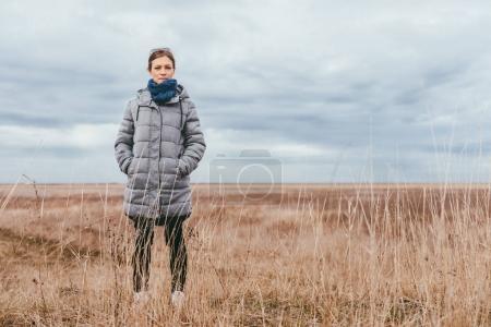Woman standing in grassland