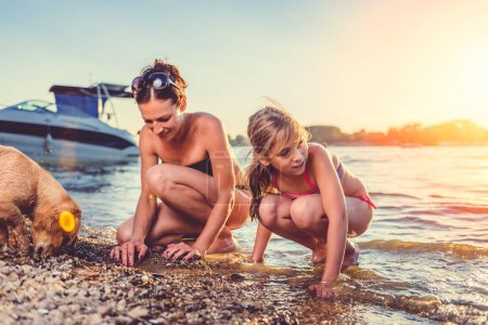 Mother with daughter and dog enjoying