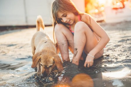 Girl with small yellow dog