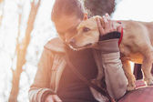 Woman gently hugging her pet dog