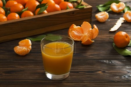 Fresh tangerine oranges on a wooden table. Peeled mandarin. Halves, slices and whole clementines closeup.