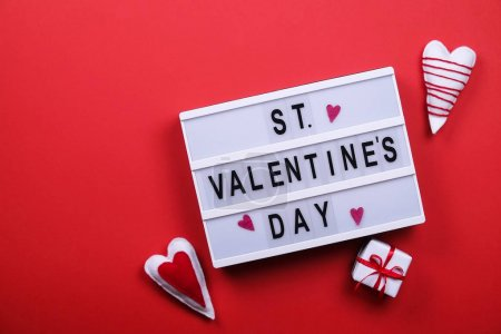 Happy valentines day / love symbols concept on bright red background