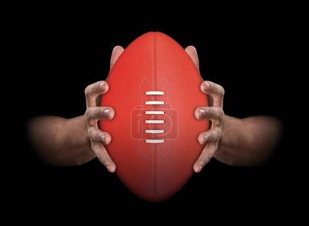 Hands Gripping Football
