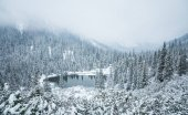 A beautiful winter landscape with a mountain lake in blizzard. Western Tatra mountains in Slovakia