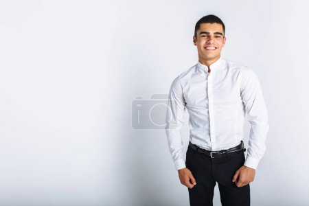 Portrait of a beautiful man posing in the Studio. White background, isolated. Stylish business man