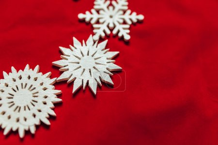 Snowflakes on a red background. Christmas toy drive.