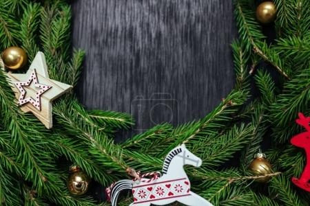 Christmas background. Black background. Real tree. Background for text. Christmas toys