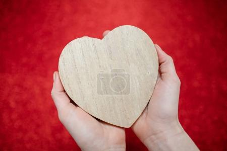 a sparkling red background, rhinestone,Valentine's Day gift for the second half, a romantic photo, a wooden heart on a red background, suitable for text insertion